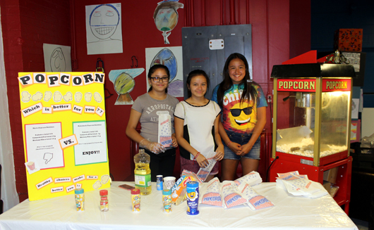 children with popcorn stand at Healthy Carnival