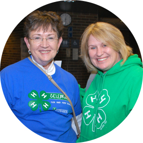 two 4-H volunteers