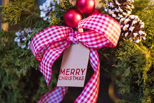 Evergreens with gingham checked ribbon and Merry Christmas tag