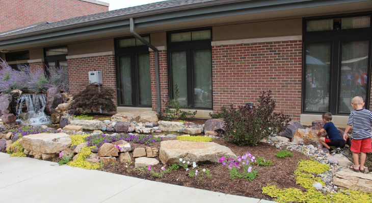 children explore garden space at Community Cancer Center, Normal.