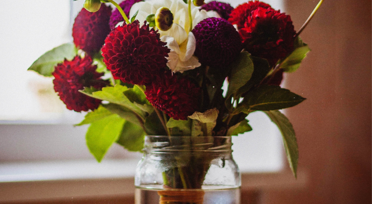 assorted cut flowers in a wide mouth jar. credit: