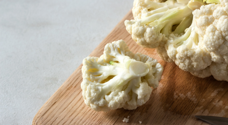 Three slices of cauliflower on a cutting board.