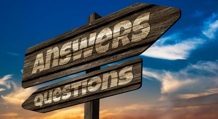 "Sign post with ""answers"" pointing to the right and ""questions"" pointing to the left."