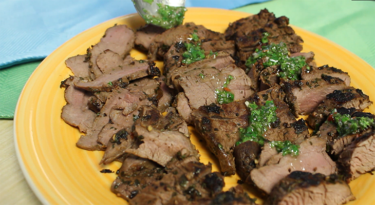 Chimichurri sauce over sliced venison