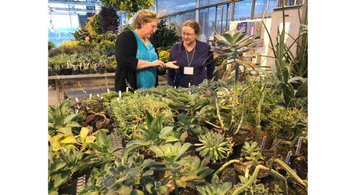Parkland College Horticulture Instructor, Theresa Meers, teaches Master Gardener Trainee, Margaret Briskin, about succulents at tour of the Parkland greenhouses during the 2019 Master Gardner Training Course.