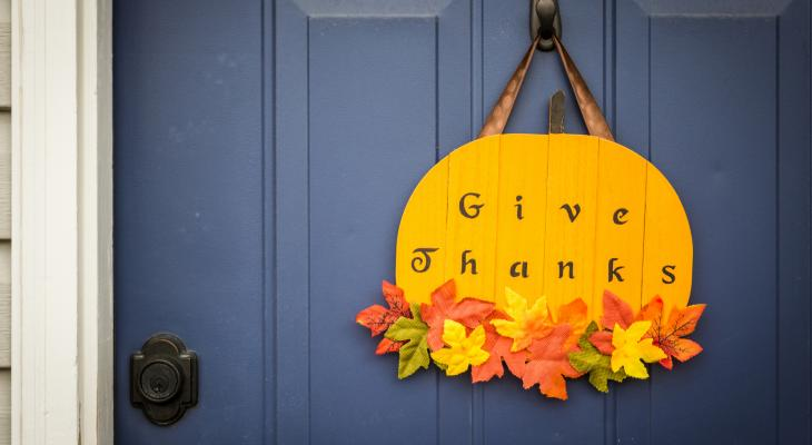 Give Thanks pumpkin decoration hanging on front door