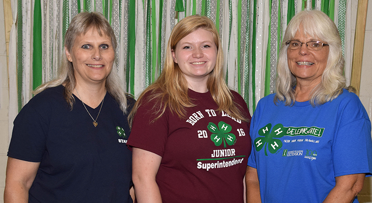 three 4-H staff members in group photo