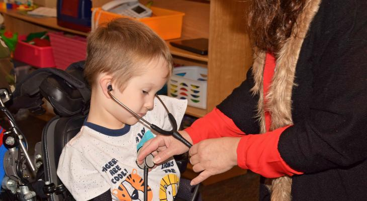 little boy in wheelchair using stethoscope
