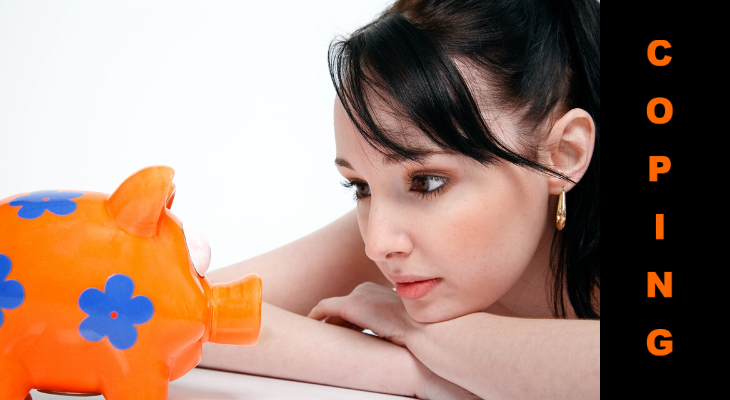 Picture of young woman staring at piggy bank with word, coping, next to her.