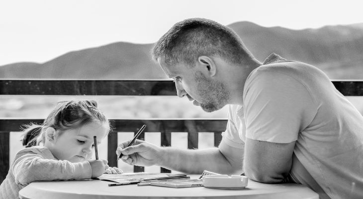 father with child writing
