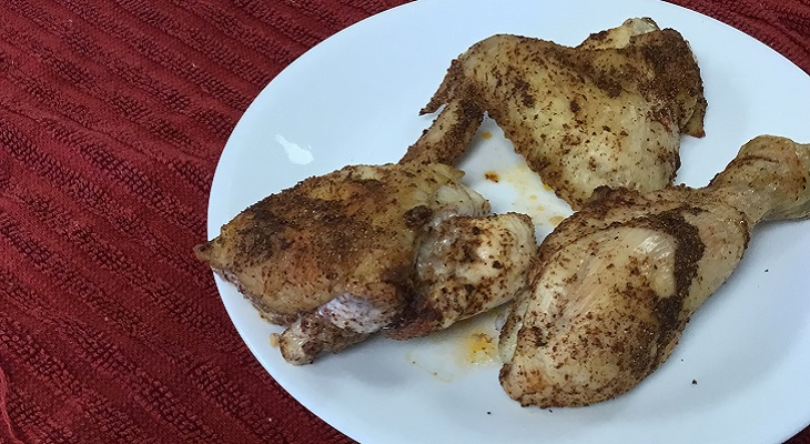 Cooked chicken wing, leg, and thigh