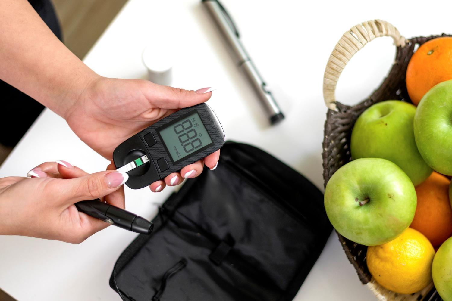 fruit bowl and blood sugar meter