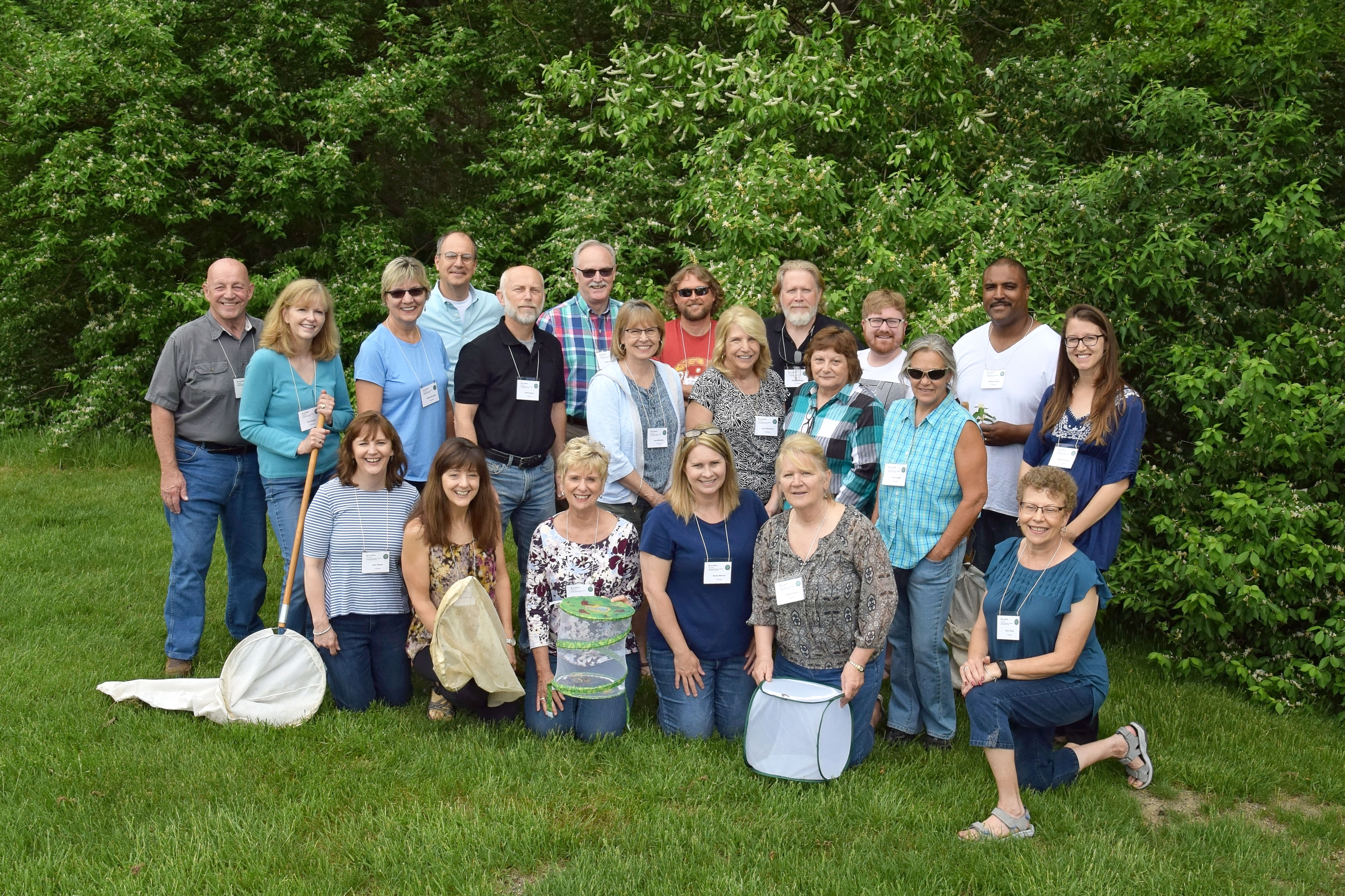 group of Extension Master Gardeners outside with trees in background