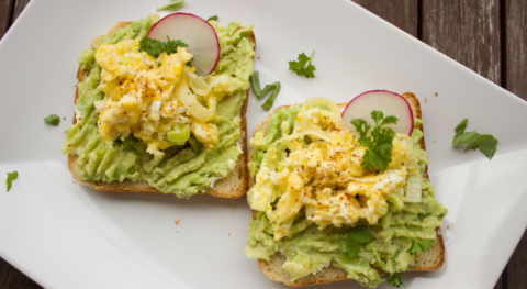 two slices of bread with avocado and eggs